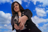Woman with handgun — Stock Photo