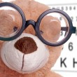 Teddy with glasses - Stock Photo