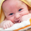 Stock Photo: Three month old baby with towel