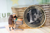 Old woman and euro money — Stock Photo
