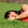 Dreaming pretty girl in the green grass — Stock Photo #9945558