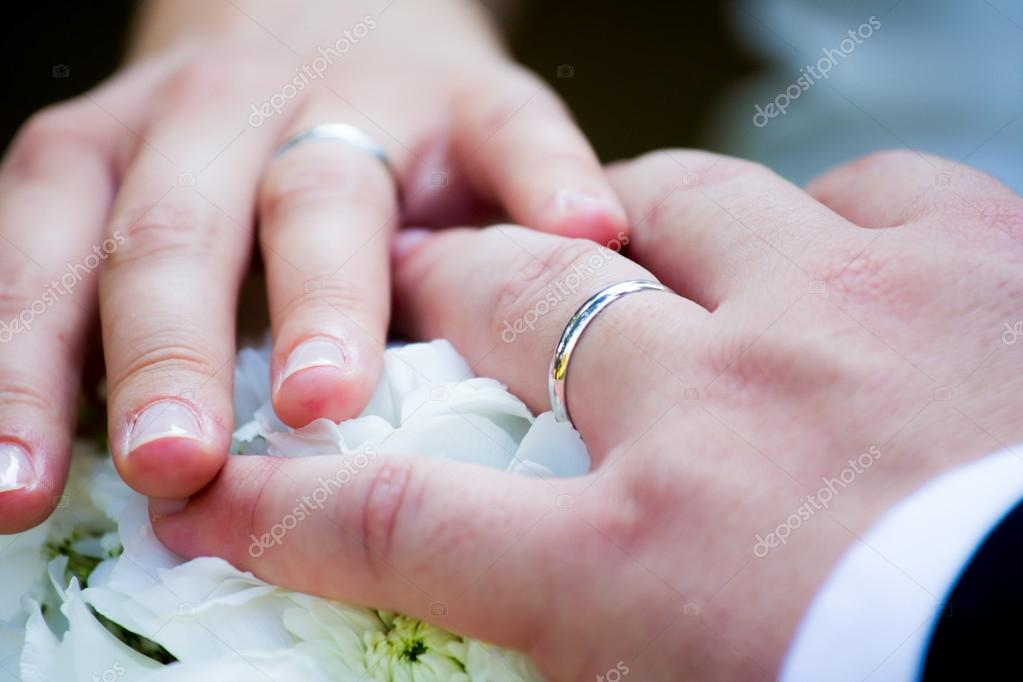 Hands with wedding ring — Stock Photo #12763569