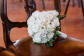 Bouquet on a chair — Stock Photo