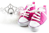 Tiara crown and baby shoes — Stock Photo
