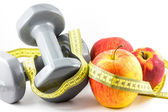 Apple, dumbbell and tape — Stock Photo