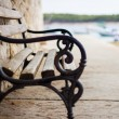 Wooden and iron bench — Stock Photo