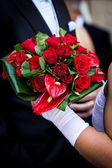 A Bride with a red wedding bouquet — Stock Photo