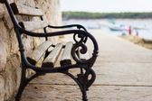 Wooden and iron bench — Foto Stock