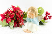 Holy baby Angel with poinsettia — Stock Photo