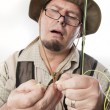 Stock Photo: Fly fishermthreading line