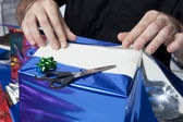 Wrapping a present — Stock Photo