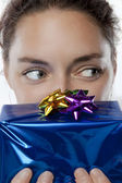 Gorgeous woman with a gift — Foto Stock