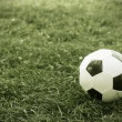 Soccer ball on the field of stadium - Stok fotoraf