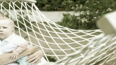 Happy baby with mother in hammock — Stock Video