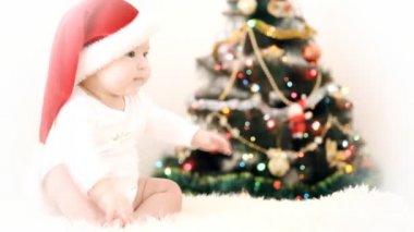 Baby in Christmas hat on the new year background — Stock Video