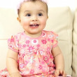 Smiling baby sitting on the sofa — Stockvideo