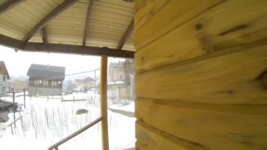 Man sitting in hot water outdoor at winter — Stock Video