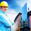 Young architect wearing a protective helmet standing on the buil — Stock Photo #6354231