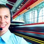 Businesswomen and train on speed in railway station — Stock Photo #6371711