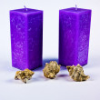Violet candles and cockleshells — Stock Photo