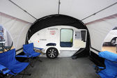 Small camper Caretta with awning — Stock Photo