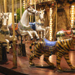 Mery-go-round carousel horses and tiger at night - 图库照片