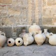 Ancient amphoras in a monastery yard — Stock Photo