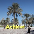 Slogan Achieve on the corniche of Doha, Qatar — Foto de Stock