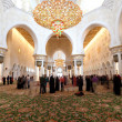 Stock Photo: Visitors inside of Sheikh Zayed Mosque in Abu Dhabi, UAE