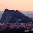 The Rock of Gibraltar and spanish town La Linea at night — Stock Photo #16164615
