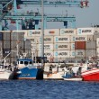 Fishing boats at the container terminal in Algeciras, Spain - Stock Photo