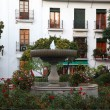 Small fountain in the city of Estepona, Costa del Sol, Andalusia, Spain — Stock Photo