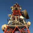 Stock Photo: Communication tower with many different antennas