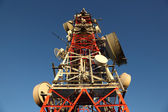 Communication tower with many different antennas — Foto de Stock