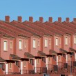 Stock Photo: Row of red residential houses in urbanization in Spain