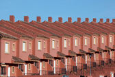 Row of red residential houses in a urbanization in Spain — Stock Photo