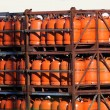 Stock Photo: Propane gas bottles in storage