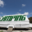 Old caravan used as a camping sign — Stock Photo