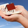 New house and money over sky background — Stock Photo