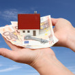 House with money and key with sky background — Stock Photo