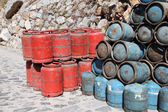 Red and blue propane gas bottles in Morocco — Stock Photo