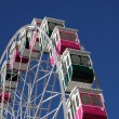 Stock Photo: Colorful ferris wheel at summer fairground
