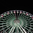 Stock Photo: Illuminated ferris wheel at summer fairground