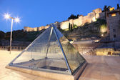Glass pyramid at the roman amphitheatre ruin in Malaga, Spain — Stock Photo