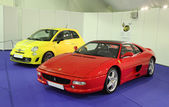 Ferrari 355 F1 GTS and a yellow Fiat Abarth at the Ferrari Exhibition in Estepona on July 29, 2013. Andalusia Spain — Foto de Stock