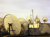 Satellite dishes on the rooftop at night — Stock Photo