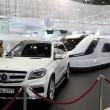 DUSSELDORF - SEPTEMBER 4: Mercedes Benz SUV and a modern camper van Caravisio by Knaus Tabbert at the Caravan Salon Exhibition 2013 on September 04, 2013 in Dusseldorf, Germany. — Stock Photo