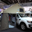 Stock Photo: DUSSELDORF - SEPTEMBER 4: Ford Ranger truck with camping tent at CaravSalon Exhibition 2013 on September 04, 2013 in Dusseldorf, Germany.