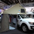 DUSSELDORF - SEPTEMBER 4: Ford Ranger truck with camping tent at the Caravan Salon Exhibition 2013 on September 04, 2013 in Dusseldorf, Germany. — Stock Photo