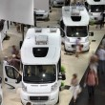 DUSSELDORF - SEPTEMBER 4: Modern Camper vans and caravans presented at the Caravan Salon Exhibition 2013 on September 04, 2013 in Dusseldorf, Germany. — Stock Photo